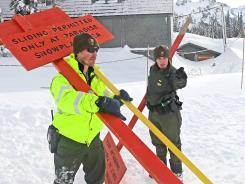 Margaret Anderson, right, a law enforcement ranger at Mount Rainier National Park, works at Mount Rainier, Wash., on Saturday. Anderson was shot and killed on New Year's Day.