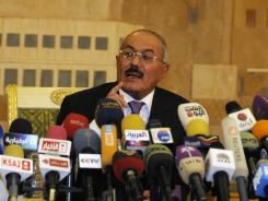Yemen's outgoing president said on Dec. 24 that he would leave the country for the United States to help calm tensions in his country.
