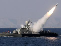Iranian navy fires a Mehrab missile in the Strait of Hormuz on Sunday.