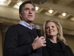 Mitt Romney and his wife Ann speak at a caucus day rally today in Des Moines, Iowa.