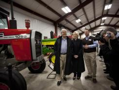 GOP presidential candidate Newt Gingrich, and his wife, Callista, tour the Heartland Acres Agribition Center on Monday in Independence, Iowa.