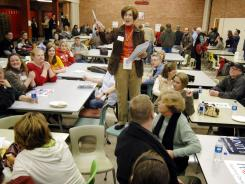 A caucus is held in 2008 in Le Mars, Iowa.