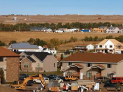 Oil production has spurred construction in Williston, N.D., above, but many residents are finding more for the money in Arizona.