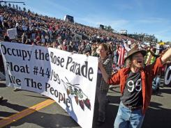 Occupy protesters march along Colorado Boulevard during the 123rd Tournament of Roses Parade in Pasadena, Calif., on Jan. 2.