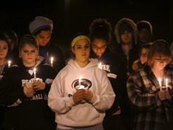Penn State students participate in a candlelight vigil in support of sexual abuse victims on Dec. 1. USA TODAY research finds that adults often encounter few penalties from concealing abuse.