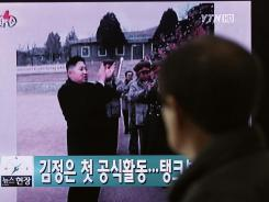 At the Seoul train station a man watches a TV report about North Korea's new leader Kim Jong Un on Monday.