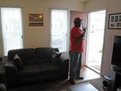 Antonio Miller stands in his new Habitat-built home in Nashville. Habitat for Humanity has asked its affiliates nationwide to build homes that meet Energy Star requirements for efficiency.