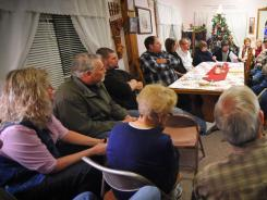 Voters debate during a caucus of precinct 42 near Smithland, Iowa, on Tuesday.