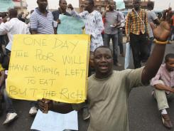 An unidentified man protests on a major road during a fuel subsidy protest in Lagos, Nigeria, on Tuesday.