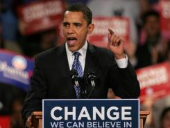 Then-Illinois Sen. Barack Obama makes a victory speech in Des Moines after winning the Iowa Democratic caucuses on Jan. 3, 2008.