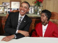 President Obama visits Endia Eason at her Cleveland home, which she and her husband almost lost to a predatory lender.
