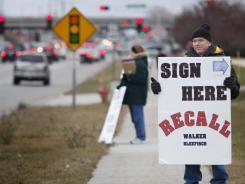 Volunteer Dan Mitchell of Appleton tries to bring in signatures Dec. 20.