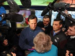 Surrounded by the media, Rick Santorum visits a diner in Tilton, N.H., on Thursday.