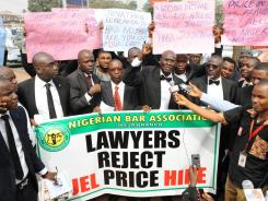 Members of the Nigerian Bar Association march Thursday in Lagos to protest soaring fuel prices.