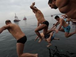 Swimmers race to catch a wooden cross during an Epiphany ceremony to bless the water, in Greece's northern port city of Thessaloniki, Jan. 6.