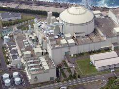 An aerial view shows the Monju prototype fast breeder nuclear reactor's building, which was constructed circa 1970.