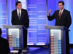Former Massachusetts governor Mitt Romney and former Pennsylvania senator Rick Santorum participate in Saturday night's GOP presidential debate in Manchester, N.H.