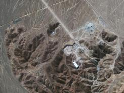 This Sept. 26, 2009 satellite image shows a facility under construction inside a mountain in Iran. Iran has begun uranium enrichment at a new underground site.