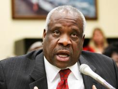 Supreme Court Justice Clarence Thomas criticizes the court's rationale that allows more regulation of broadcast TV than cable.