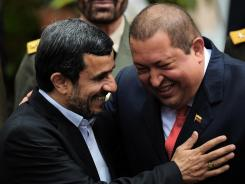 Venezuelan President Hugo Chavez, right, and his Iranian counterpart Mahmoud Ahmadinejad, smile Monday at Miraflores presidential palace in Caracas.