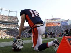 Tim Tebow kneels in prayer before the Denver Broncos played  the Pittsburgh Steelers on Sunday.