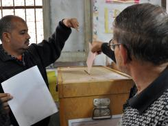 A man casts his ballot at a Cairo polling station on Nov. 28.