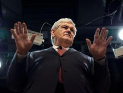 Former House speaker Newt Gingrich, addressing a town hall Monday in Nashua, N.H., has sharply criticized Mitt Romney for not running interference on ads.