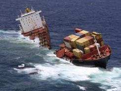The cargo ship Rena is split in two and sits on a reef near Tauranga, New Zealand, on Monday.
