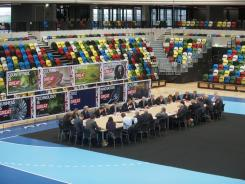 Britain's Prime Minister David Cameron holds a Cabinet meeting in the handball arena at the 2012 Olympic Games site on Monday.