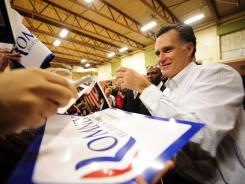 Mitt Romney greets supporters Monday after addressing a rally at McKelvie Intermediate School in Bedford, N.H.