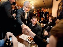 Republican presidential candidate Ron Paul campaigns Monday in Manchester, N.H.