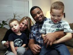 Seattle family: Damon and Bethany Brown with sons Theo, left, and Julian. Single-kid families spend 25% more on their offspring than two-kid families spend on each of theirs.