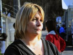 In April 2010, Michelle McKinney talks to the media in Naoma, W.Va. McKinney's father, Benny Willingham, 61, was killed in an explosion at Massey Energy's Upper Big Branch Coal Mine.