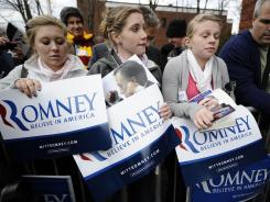Mitt Romney supporters wait outside a rally venue in hopes of getting an autograph in Rochester, N.H., on Sunday. When Rochester's votes were counted Tuesday night, Romney had won all six of its wards.