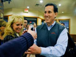 Former Pennsylvania senator  Rick Santorum greets supporters at a campaign stop in Greenville, S.C., on Sunday.