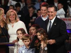 Former Massachusetts governor Mitt Romney celebrates his primary win on stage with his family at Southern New Hampshire University Jan. 10 in Manchester, N.H.
