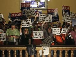 Right-to-work protestors chant at the Indiana Statehouse Tuesday following Gov. Mitch Daniels State of the State address.