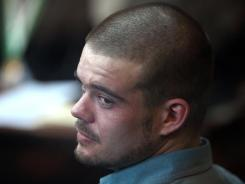 Joran van der Sloot looks back from his seat after entering the courtroom Wednesday for his trial at San Pedro prison in Lima, Peru.