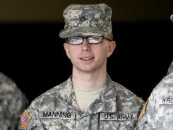 Army Pfc. Bradley Manning is escorted from a courthouse in Fort Meade, Md., in December.
