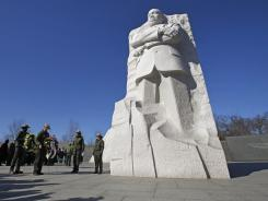 Visitors gather at the Martin Luther King Jr. Memorial on Sunday to commemorate the iconic civil rights leader.