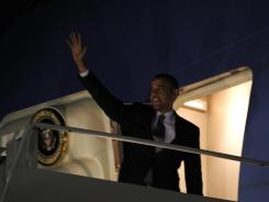 President Obama waves as he boards Air Force One on Wednesday at Chicago's O'Hare International Airport.