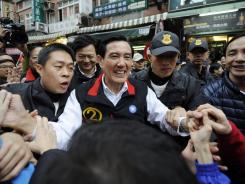 Taiwan President Ma Ying-jeou greets supporters as he campaigns Tuesday in Tamsui district, New Taipei city. He has been credited with warming ties with China.
