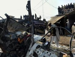 Pakistani security officials examine the site of a bombing Tuesday in Jamrud. A remote-controlled bomb killed 35 people in the Taliban-hit tribal region of northwest Pakistan.