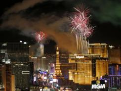 Fireworks light up the Las Vegas Strip on Jan. 1, 2012. A Roman Catholic Priest could face three years in prison for stealing money from his Las Vegas parish to support his gambling habit.