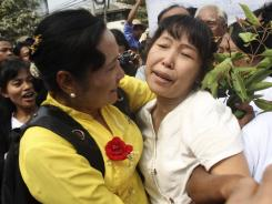 A former political prisoner, right, gets welcomed by her friends as she comes out of the Insein prison in Rangoon.