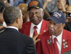 President Obama talks with two members of the Tuskegee Airmen in Oct.