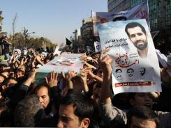 Mourners carry the coffin of Iranian nuclear scientist Mostafa Ahmadi-Roshan during his funeral in Tehran on Friday.