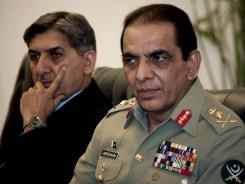 Pakistan's army chief Gen. Ashfaq Parvez Kayani, right, and Pakistan military's spy agency's chief Lt. Gen. Ahmed Shuja Pasha attend a meeting in Islamabad.
