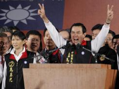 Taiwanese President Ma Ying-jeou declares his victory in the presidential election on Saturday.