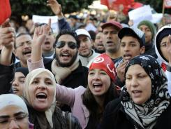 Tunisians chant slogans as they gather to mark the first anniversary of the removal of ousted president Zine El Abidine Ben Ali, in Tunis, Tunisia, on Saturday.